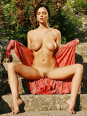 Jenya is meditating outside without any clothes to slow down her prayers.