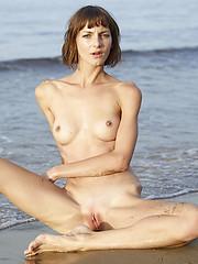 Cute skinny model on the wild beach