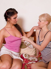 Two lesbian teens playing with a dildo