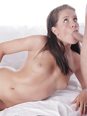 Brown-haired woman takes off her clothes