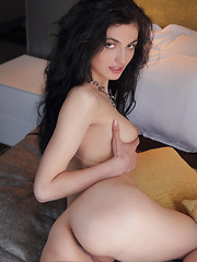 Dafna may look sweet and adorable but this cutie can lure you into lusty desires as she poses seductively all over the bed.