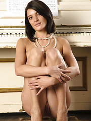With her delicate composure and elegant   beauty, Yanika displays her luscious   naked body all over the piano.