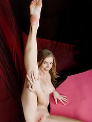 Flavia looks relaxed and comfortable as   she flaunts her gorgeous naked body and   spreads her legs on the floor to bare   her smooth, pink labia.