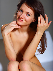 Zhanet makes an alluring and sizzling   experience as she strips and poses all   over the sofa.