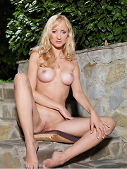 Blonde wavy hair framing an angelic yet seductive face with sweet facial features and a hot gorgeous body to boot, enjoy a pleasing company with Zemira in the outdoors.
