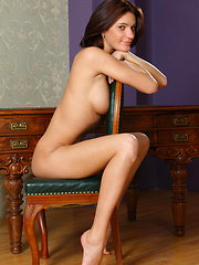 Yanika bares her awesome physique with gorgeous puffy breasts, sweeping hips, an amazingly plump butt, and an irresistible allure as she strips and poses on top of the table.