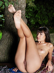 Kenna showcases her youthful allure as she strips and flaunts her slim and slender body in the outdoors.