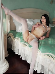 Nichole loves showing off her awesome, slender body, flaunting and posing on top of the bed baring her puffy nipples and long, sexy legs.