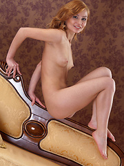Marianna shows off her acrobatic skills and flexible, athletic body and sprawls all over the leather sofa.