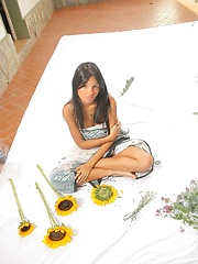 Karla Spice wears nothing but flowers over her naked body