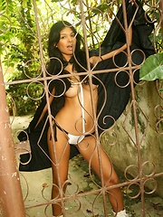 Karla Spice gets naughty in her black cape almost revealing it all