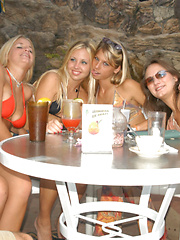 Four hot and busty lesbians have an orgy