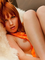 Marie McCray - sits on a fluffy couch