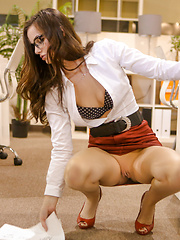 Sexy office worker Lily spices up the office