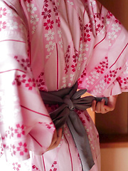 As Uri lifts up her Japanese Yukata, her silky white panties and wide hips are exposed. The thong is so thin it can't cover the creases of her booty hole.