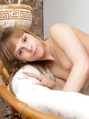 Having nice time alone at home holds always great benefits. Sweet nude lovely babe in natural way enjoy the free time.