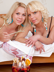 Three marvelous blonde lesbian teens stripping and showing their naughty shaved pussies.
