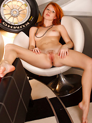 Nubile redhead Mia Sollis with absolutely beautiful breasts with pink tits and scrumptiously moist pussy with trimmed bush