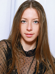 Blue-eyed darling Mika A with long brown hair, long and slender physique, and perky assets