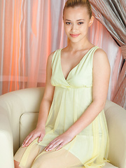 Dressed in a chiffon dress, her hair tied up in a high ponytail, a sweet charming smile lighting up her pretty face, Samera is an enchanting new model posed casually on top of teh couch
