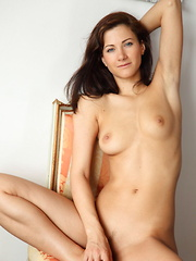 Lauren Crist takes off her sexy gold corset and panties exposing her exquisite womanly form