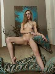 A stunning statuesque beauty Maryana is wearing turquoise lace panties and a flowy blouse