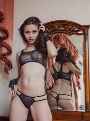Red Fox feeling sexy and alluring in her black lace lingerie with string panty that showcases her smooth, sexy butt.