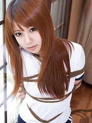 Dimdim Asian in long socks and sports outfit has hands tied