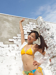 Shizuka Asian honey offers beautiful smile while posing outdoor