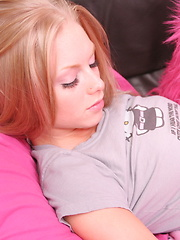 Petite blonde teen Skye shows off her pink panties as she teases on the couch