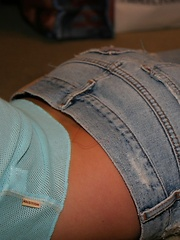 Blonde teen Skye shows off her perfect little body in a lowcut top and jeans