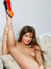 Melena A poses confidently in her hot pink lingerie that shows off her long and slender physique