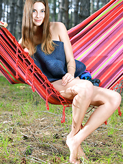 Marta E enjoys a laid-back weekend, reading a book and feeling the fresh breeze on her naked skin as she relaxes on a hammock