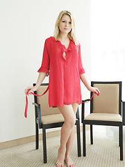 Lucy Heart smooth fair skin accentuated by a red chiffon robe