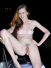 Emily Bloom  showing off her youthful assets in an outdoor shoot