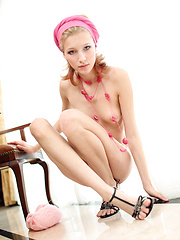 innocent Mila F strips out of her pink top to reveal her pretty breasts