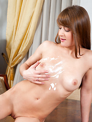 Newcomer Veronica Eve rubs her boobs and bald pussy with lotion