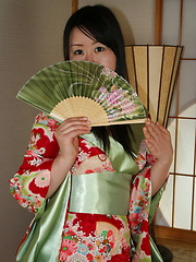 This young Geisha gives a good service to her foreign guest