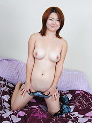 19 year old Chiyo strips and spreads to show her tight hairless gate of heaven