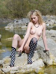 Hot curvy blonde teen sunbaths after doing a fantastic strip and tease show with her flawless slim body in a lake.