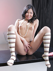 Hot Asian cutie with tiny perky tits spreads open her wet pink twat