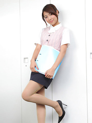 Naoho Ichihashi Asian in tight skirt is a very attractive doll