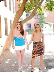 Danielle and Leslie make out under the trees