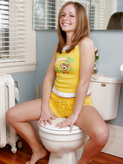 A confused Little Cookie wonders why posing on the toilet would be hot to somebody