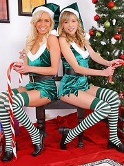 Two teen girls fuck santa and his elf helper both teens are smoking hot tone gets cream pied and the other swallows the cum
