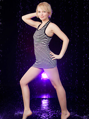Feeona A posing in her boy-hugging dress before sprawling sensually on the cold, damp floor.