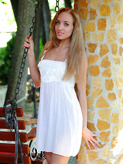 Barefoot, wearing no makeup and just a plain white dress, Tayra A's natural beauty and carefree charm stands out especially when she starts getting naked and posing without inhibition.