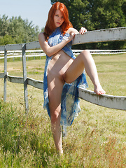 A dip-dyed blue sarong wrapped around Mia Sollis' curvy body helps bring out her striking red hair and gorgeous fair porcelain skin with delightfully pink and puffy bits.