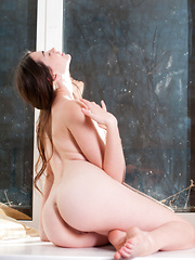 A stunning maiden with delicate beauty, her name is Lukki Lima. Blessed with a long slender body with fair, porcelain smooth skin and puffy assets, she's truly a sight to behold, naked and confident by the window.