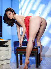 Aza's red dress compliments her sultry looks and teasing stare as she sensually undresses to showcase her tight physique and well-toned assets.